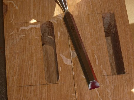rounded and squared mortise with chisel shown